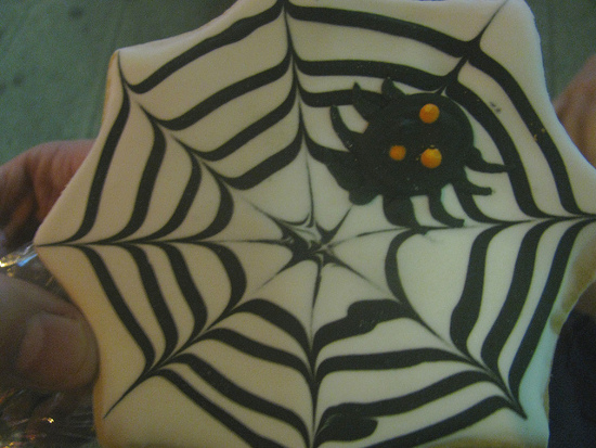 Black and white spiderweb cobweb cookie design with spider