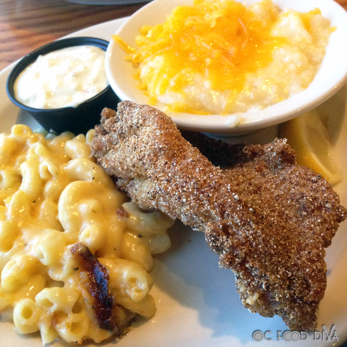 u s farm raised catfish country dinner plate is served with two country vegetables n sides plus complimentary buttermilk biscuits or corn muffins with