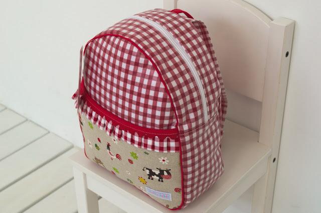 mochila animalitos rojo