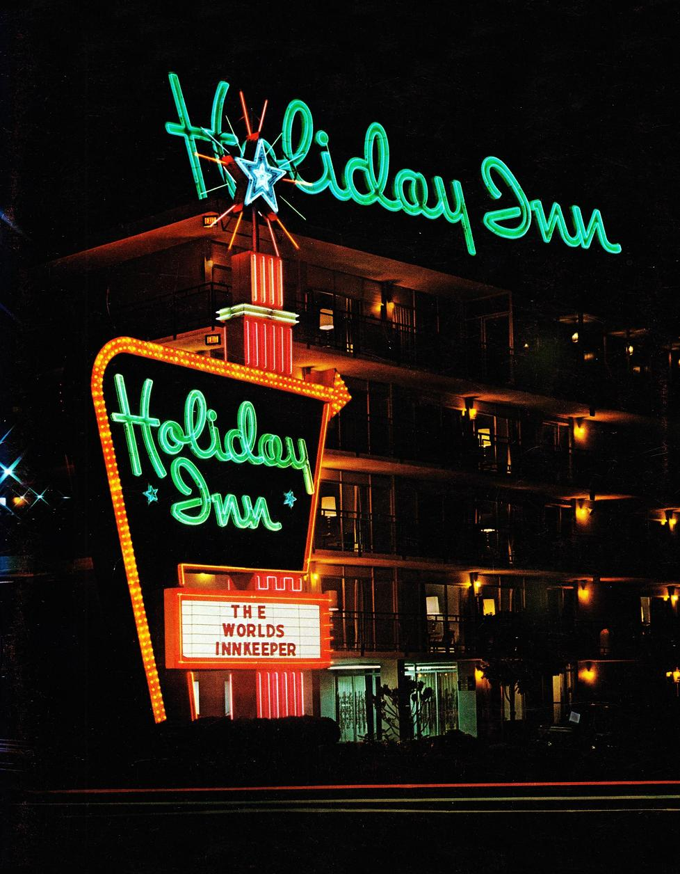 The great sign combines with a rooftop sign to form a powerful image 1972