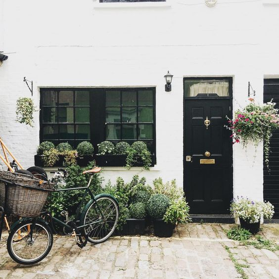 Window boxes with boxwood beautiful home exterior seen on Hello Lovely Studio