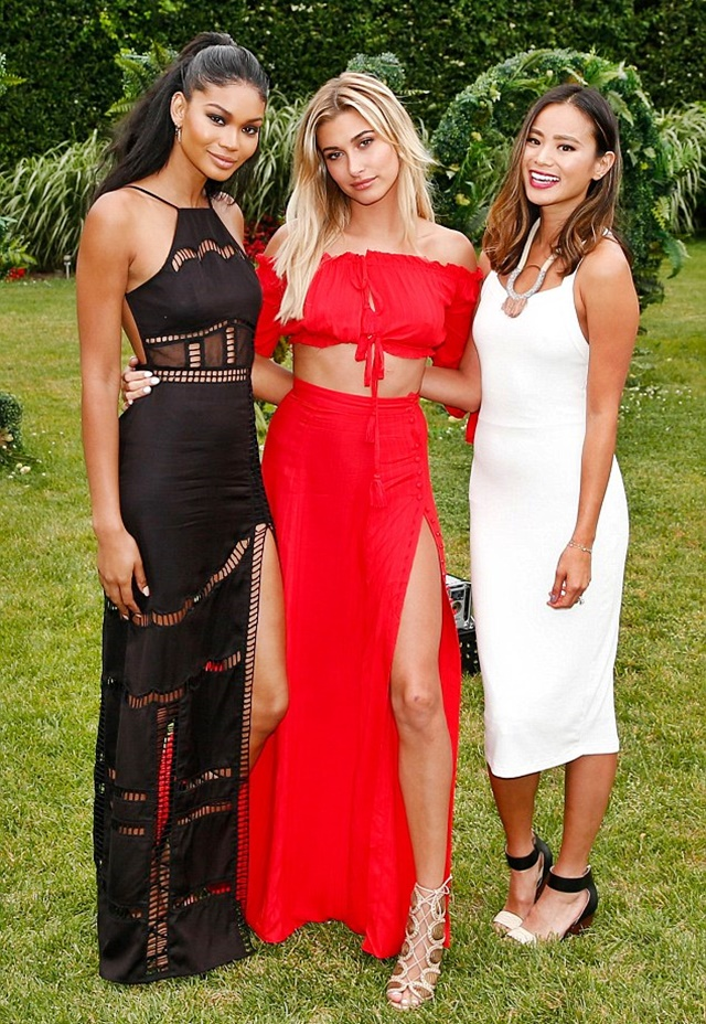 a15312ae28f Hailey Baldwin hosting the REVOLVE Summer Splash party in the  Hampton s--joined by her friends Chanel Iman and Jamie Chung .