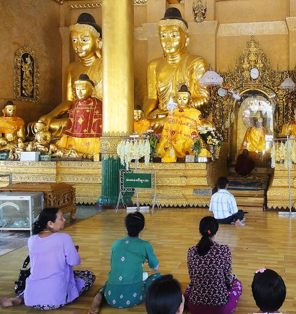 Praying to Buddha Statues