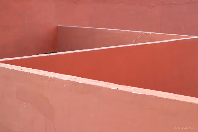 A Minimalist Photo of ZigZag Lines or English Alphabet Z being created by Overlay of Pink walls