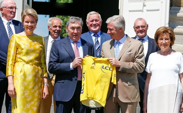Queen Mathilde wore a yellow belted Natan dress. start of the 106th edition of Tour de France cycling race in France