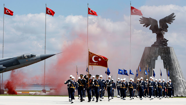 Image Attribute: Newly graduated air force cadets march during their graduation ceremony at the Air Force war academy in Istanbul, Turkey, August 31, 2009.  REUTERS/Murad Sezer/File Photo