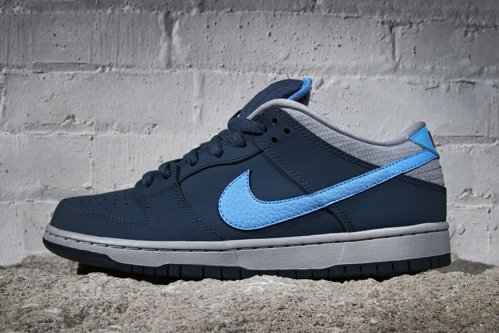 "2ef66e90c8773b Nike SB drops its January releases ahead of time with these Dunk Lows. The  ""Squadron Blue"" Dunk Lows come done up in deep navy nubuck and nylon"