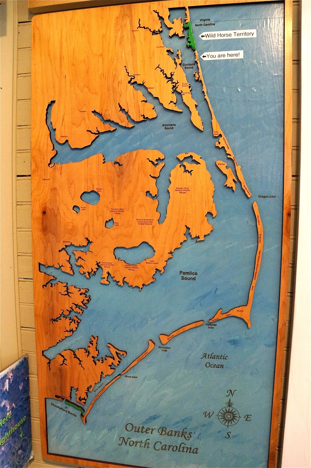 the outer banks did not mean anything to us until we carefully looked at a map and saw the long thin broken strip of islands sheltering the mainland of