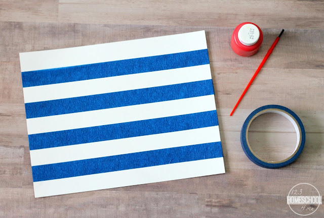 use blue painters tape to make stripes on white cardstock