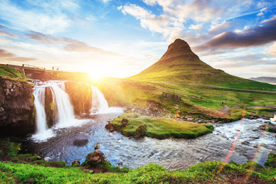 Sunset and waterfall at  Kirkjufell mountain during July in Iceland