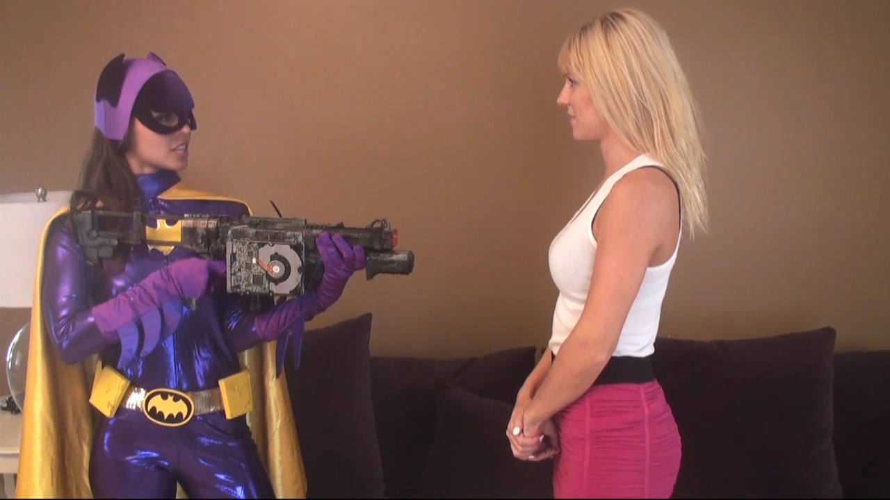 Reporter Striped to Nude on Live TV- Batgirl is to Blame!