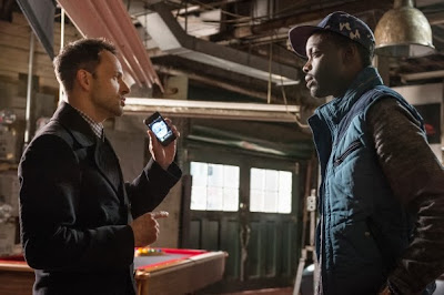 Ato Essandoh guest stars as Sherlock's sponsor Alfredo Llamosa with Jonny Lee Miler as Sherlock Holmes in CBS Elementary Season 2 Episode 11 Internal Audit