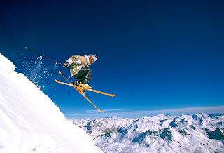 Skiing down a steep slope
