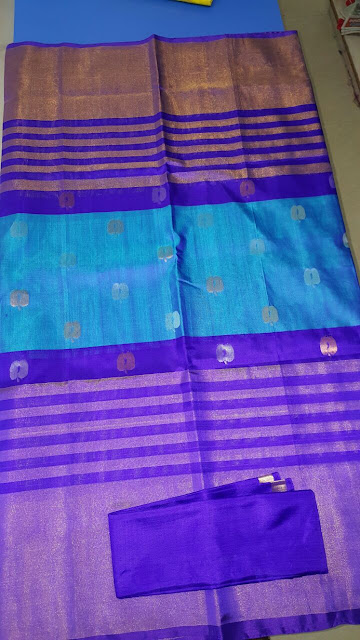 Uppada blue color saree with small apple butta