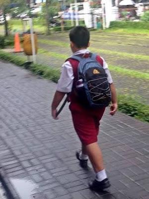 Anak SD Dermawan