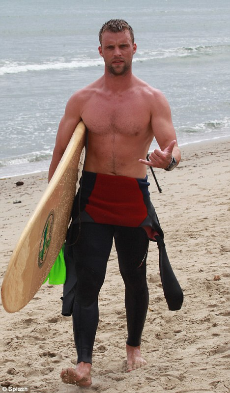 The Aquarius with shirtless athletic body on the beach