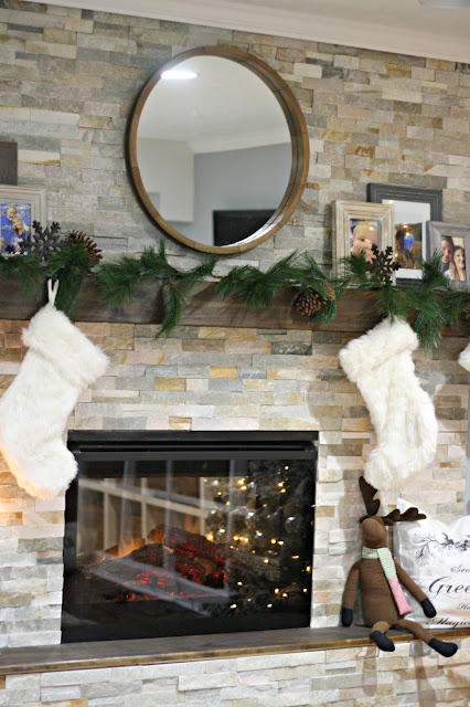 stone fireplace with wood hearth and mantel