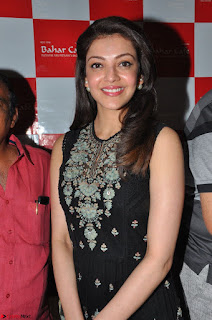 Kajal Aggarwal in lovely Black Sleeveless Anarlaki Dress in Hyderabad at Launch of Bahar Cafe at Madinaguda 025.JPG
