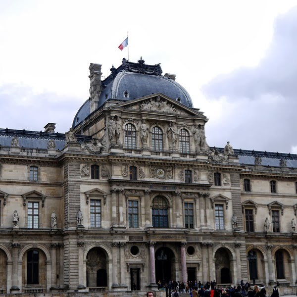 The Louvre and the French flag in Paris