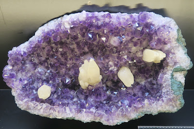 Amethyst geode with inclusions. Mineral Dept. Museum of Natural History