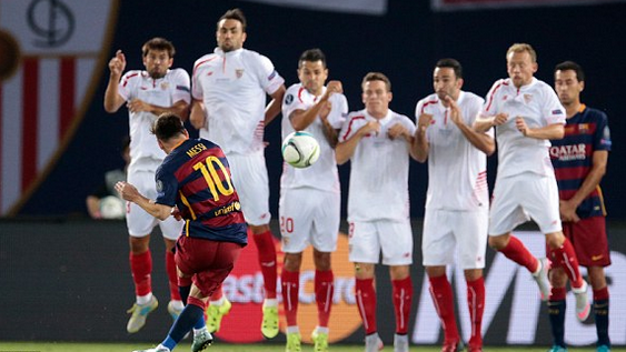 Lionel Messi curling a free-kick over the Sevilla wall.