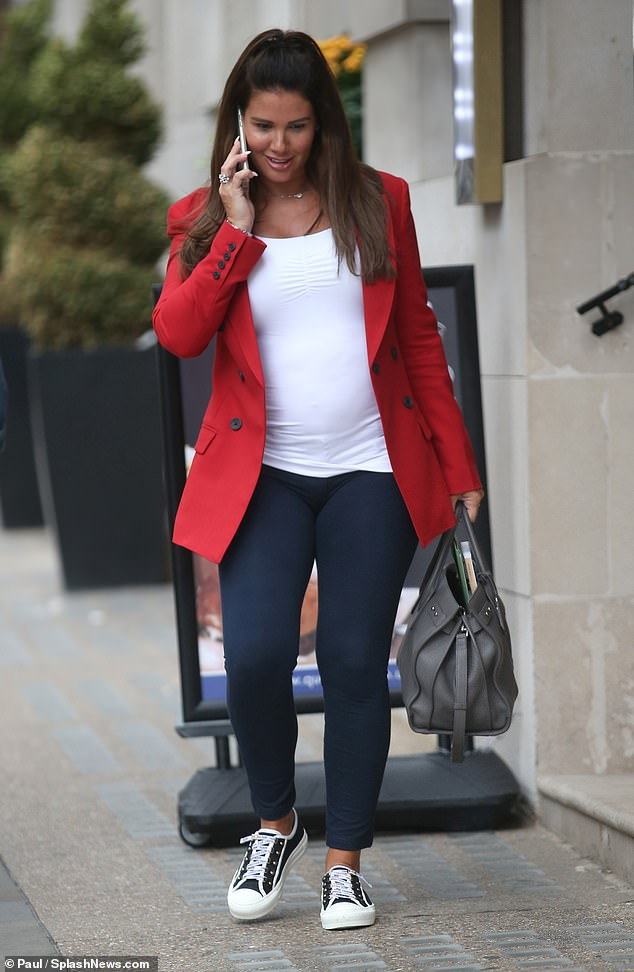 Rebekah Vardy shows her pregnancy bump  in form-fitting white top (Photos)