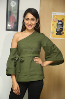 Pragya Jaiswal in a single Sleeves Off Shoulder Green Top Black Leggings promoting JJN Movie at Radio City 10.08.2017 084.JPG