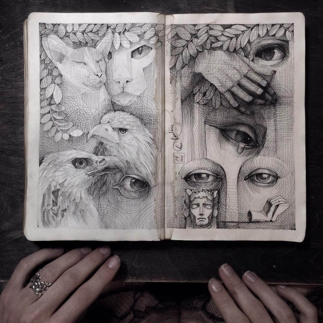 02-Eagles-and-Eyes-Lena-Limkina-Intricate-Moleskine-Drawings-with-Cats-www-designstack-co