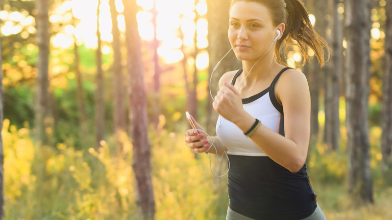girl running using Health and Fitness Apps on smartphone