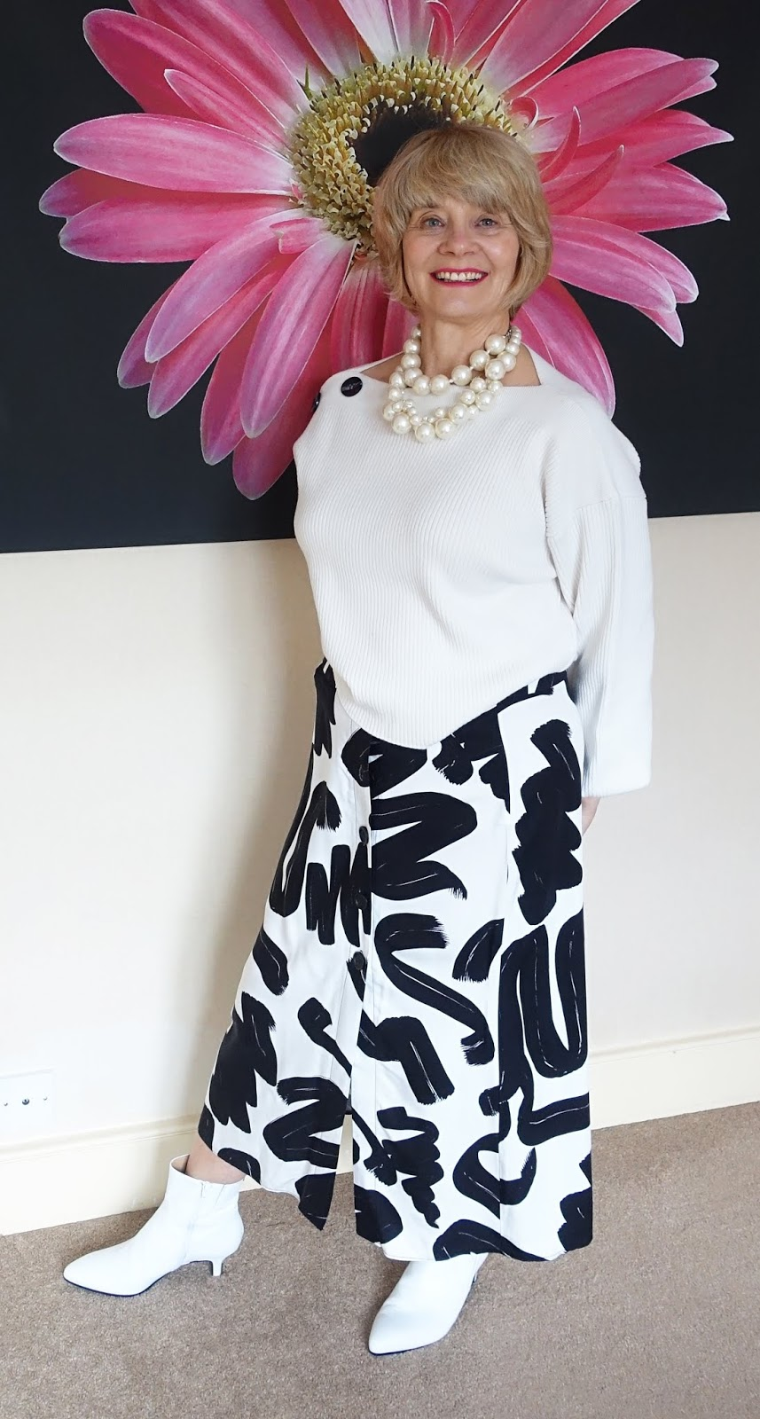 Take an abstract patterned white and black midi skirt and pair with a baggy white jumper and white boots for a modern, contemporary look that will flatter women of any age