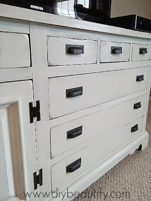 Turn an old dresser into a fabulous and chic farmhouse style console table following this tutorial at DIY beautify!