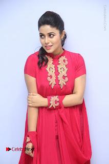 Actress Poorna Latest Stills in Red Dress at Rakshasi First Look Launch  0091.JPG