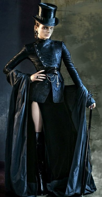 A high fashion version of the Steamgoth. A neo-victorian steampunk outfit with a classic gothic flair. Top hat, double breasted jacket, skirt, cane and boots. Women's steampunk fashion..