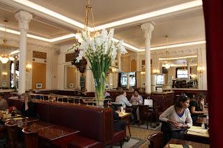 Café Les Deux Magots, where they used to meet Verlaine, Mallarmé, and Rimbaud....