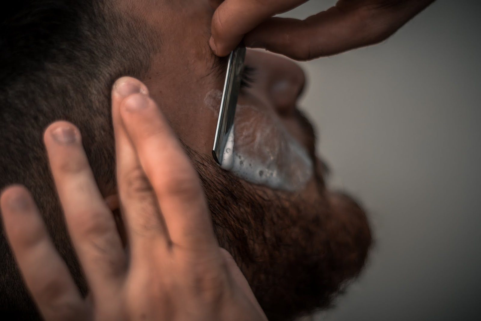 a man having a close cut shave to take care of their skin