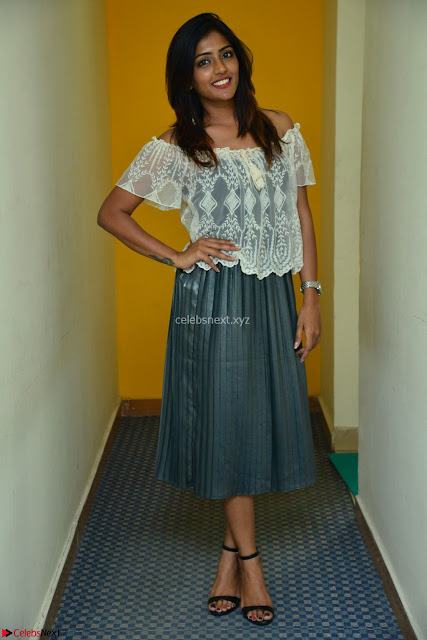 Eesha in a cute deep neck top and Skirt at at Big FM 001.JPG