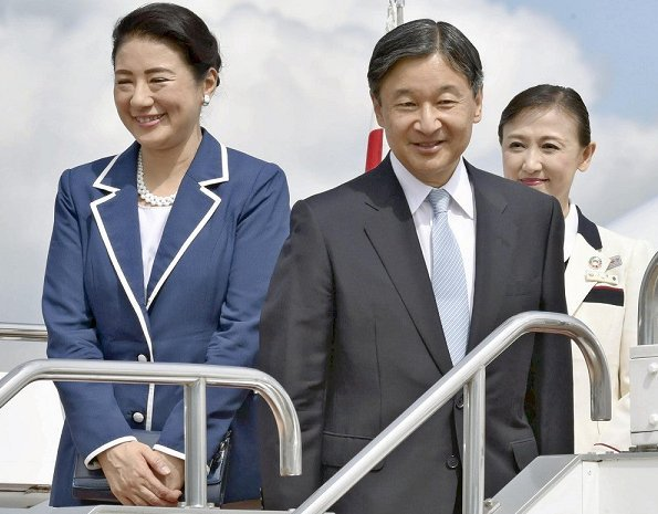 Masako wore a navy blue blazer with white border
