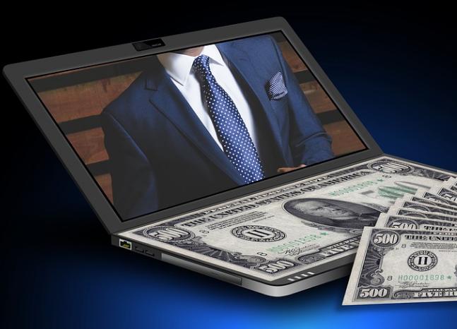 Gambar laptop dan uang