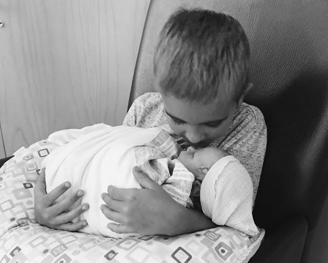 big-brother-kissing-baby-sister