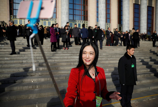 Image Attribute: A journalist reports outside the Great Hall of the People ahead of the opening session of the National People's Congress (NPC) in Beijing, China, March 5, 2017. REUTERS/Damir Sagolj