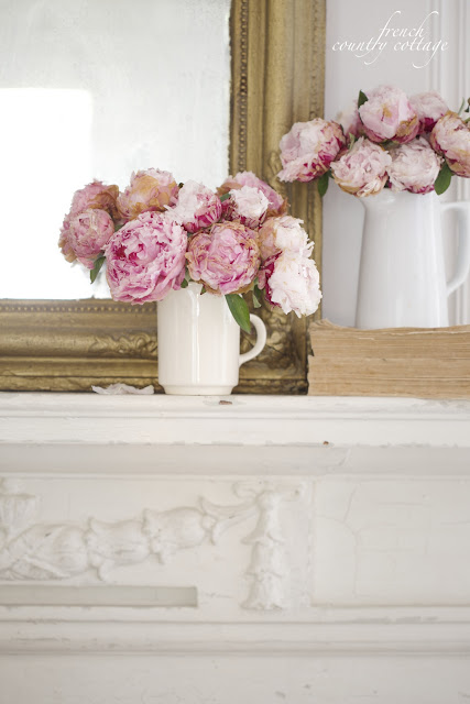 French Country Cottage Fireplace Mantel with Peonies and gold mirror