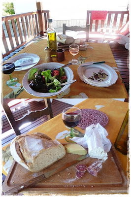 French lunch of cheeses,meats, bread, olive oil, wine