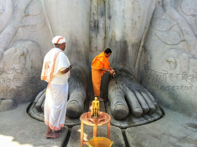 Offerings being made to the mighty Baahubali of Shravanabelagola, Karnataka