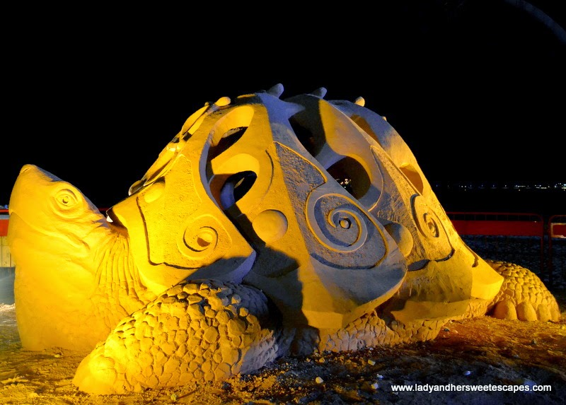sand sculpture of a gigantic tortoise at JBR beach