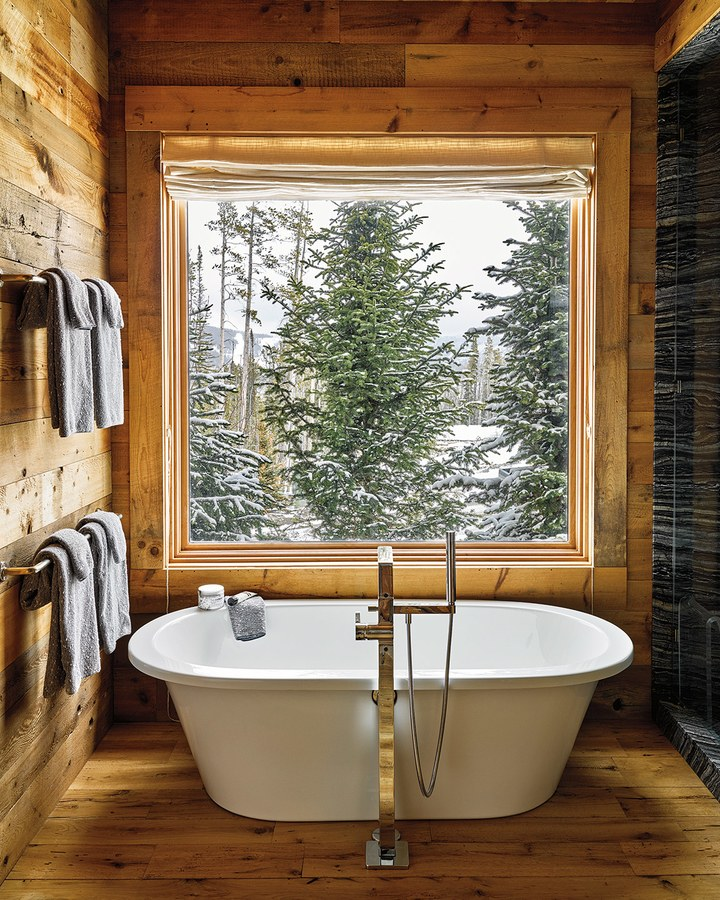 Ken Fulk rustic luxury bathtub in bathroom with wood walls in Montana ski house Sky High