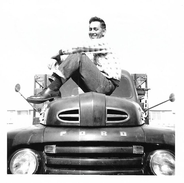Proud Teenager sitting on his new Ford Truck circa 1950s.