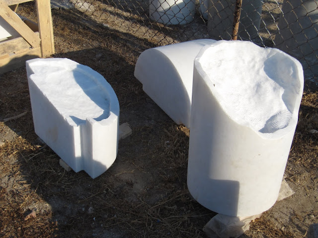 Glittering white Naxian marble ready-shaped for mounting old marble remnants