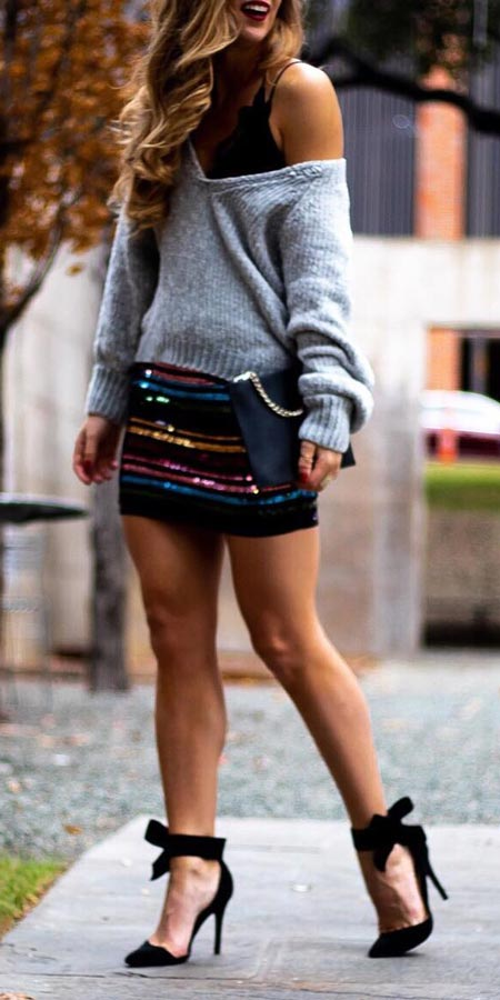 V neck sweater, high waisted mini skirt, sandals, Purse | From knit sweaters to knit sweater dress, knit cardigan dress to knitting cardigan. There are so much to try in knitwear fashion. Here are 25 cute knit outfits ideas to wear. knitting clothes and knitted outfits via higiggle.com #sweaters #knit #outfits #style