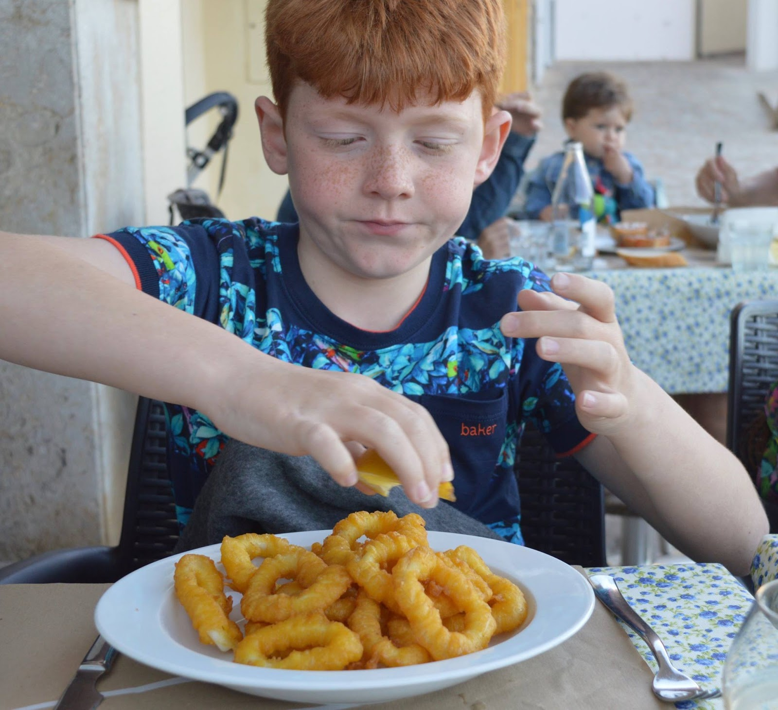 A Dad's Top 10 Holiday Essentials #MarkWarnerDad - Harry eating Calamari