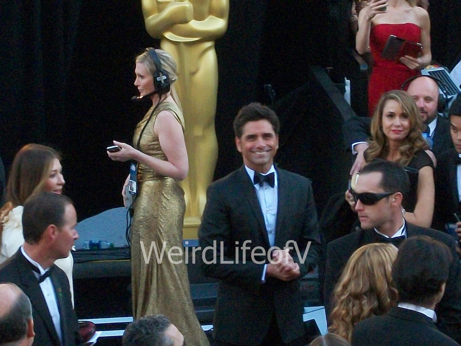 John Stamos smiling at the fans